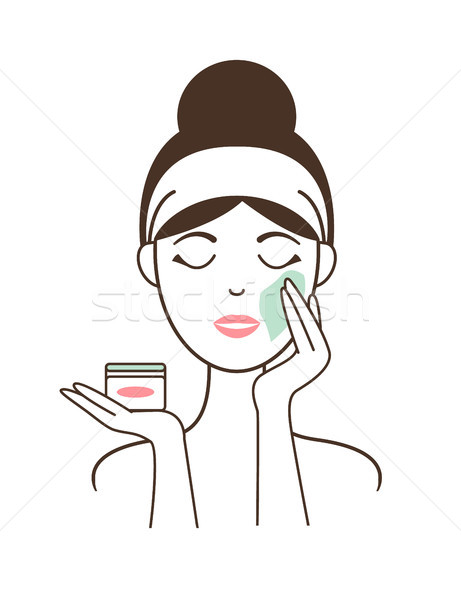 Woman Applies Soft Delicate Cream on Her Face Stock photo © robuart