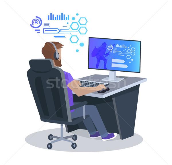Człowiek gry gra komputerowa posiedzenia krzesło biurowe słuchawki Zdjęcia stock © robuart