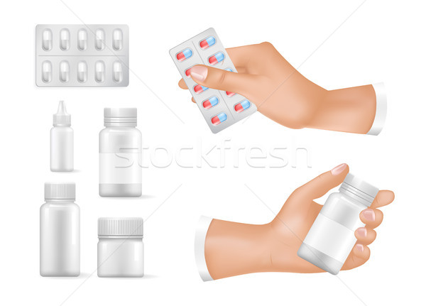 Empty Containers for Medicines in Human Hands Set Stock photo © robuart