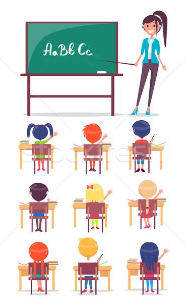 Lição escola primária crianças sentar-se secretária estudar Foto stock © robuart
