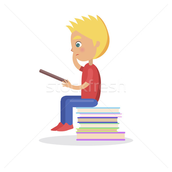 Profile of Blond Boy Sitting on Heap of Books Stock photo © robuart