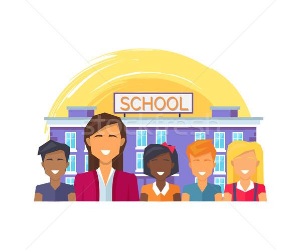 ストックフォト: 学校 · 教師 · 子供 · 笑みを浮かべて · 優しい · フル