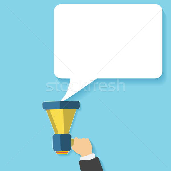 Hand holding a yellow megaphone with bubble Stock photo © robuart