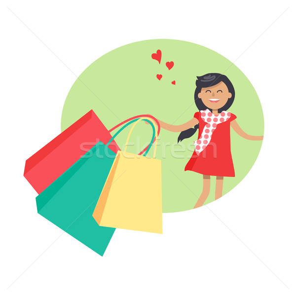 Purchasing Concept with Smiling Girl Holding Packs Stock photo © robuart