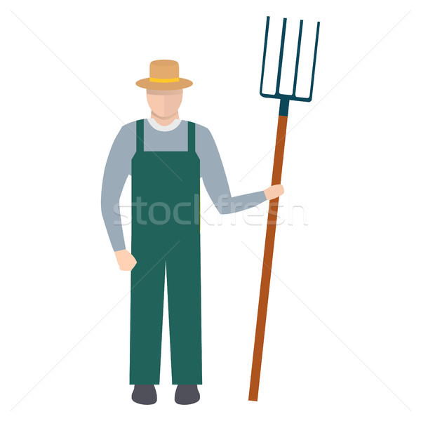 Farmer with a Pitchfork in Hat and Green Overalls Stock photo © robuart