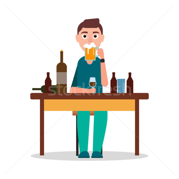 Man Sitting by Table with Lot of Alcohol Drinks Stock photo © robuart