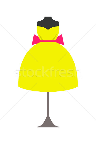 Mannequin in Bright Yellow Dress with Pink Bow Stock photo © robuart