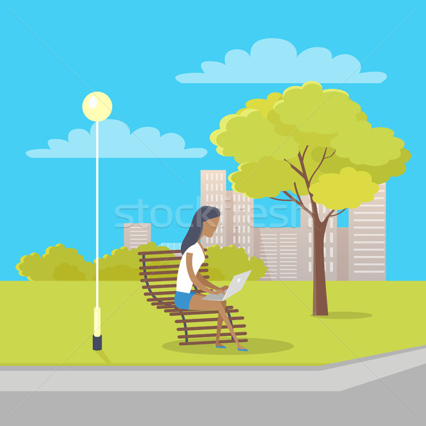 Woman with Laptop Sits on Bench in City Park Stock photo © robuart