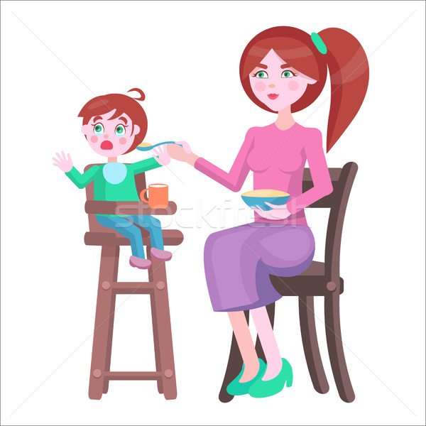 Mother Feeds Baby, Who Sits and Cries on Highchair Stock photo © robuart