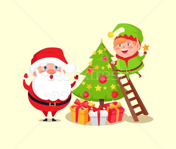 Santa Claus and Elf Decorating Christmas Tree Stock photo © robuart