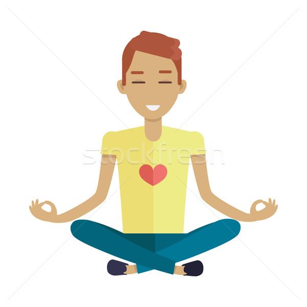 Young Man Making Meditation in Lotus Pose Stock photo © robuart