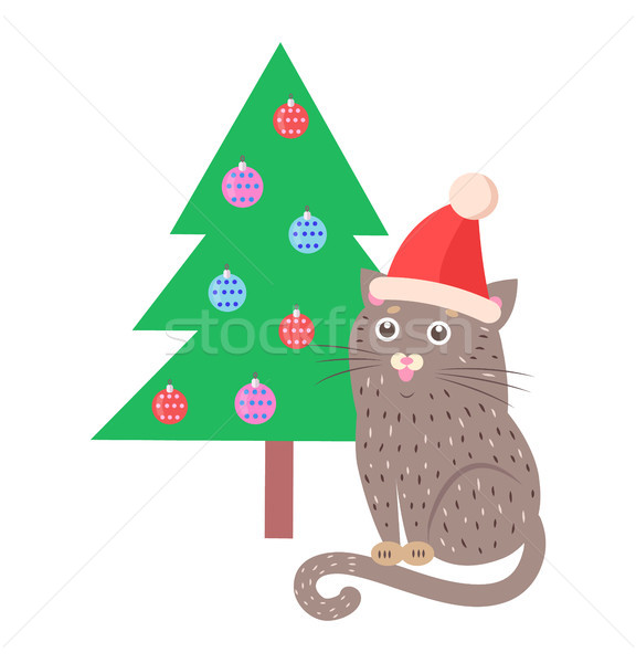 Stock photo: Funny Cat in Red Hat Sitting Near Christmas Tree