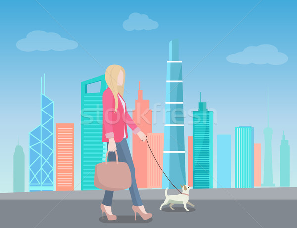Woman Walking in City with Dog on Leash Skyscraper Stock photo © robuart