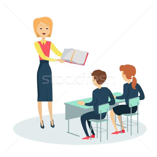 Kettő ül iskola asztal mosolyog tanár Stock fotó © robuart