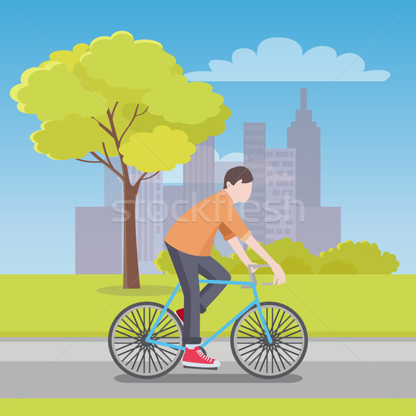 Man Rides Bicycle Along Road with City on Horizon Stock photo © robuart
