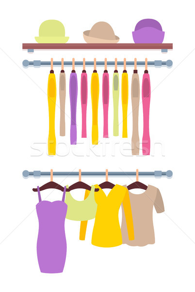 Clothes Hanging on Hangers in Women Clothing Store Stock photo © robuart