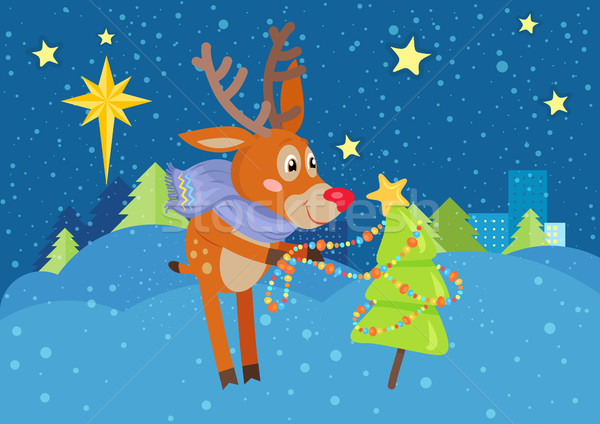Deer in Scarf Decorating Christmas Tree at Snow Stock photo © robuart