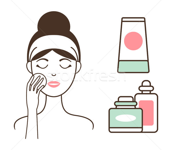 Woman Cleans Face Skin with Lotions and Tonics Stock photo © robuart