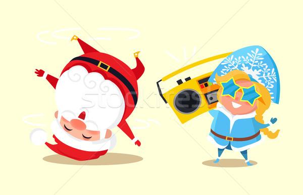 Stock photo: Santa Standing on Head Break Dancing Snow Maiden