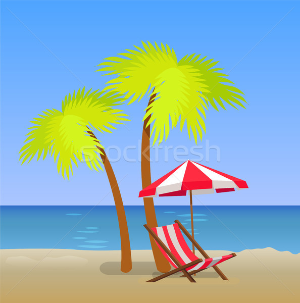 Tropical Beach with Chaise Lounge Under Pam Trees Stock photo © robuart