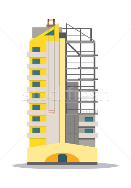 Részben befejezetlen citromsárga épület felhőkarcoló izolált Stock fotó © robuart