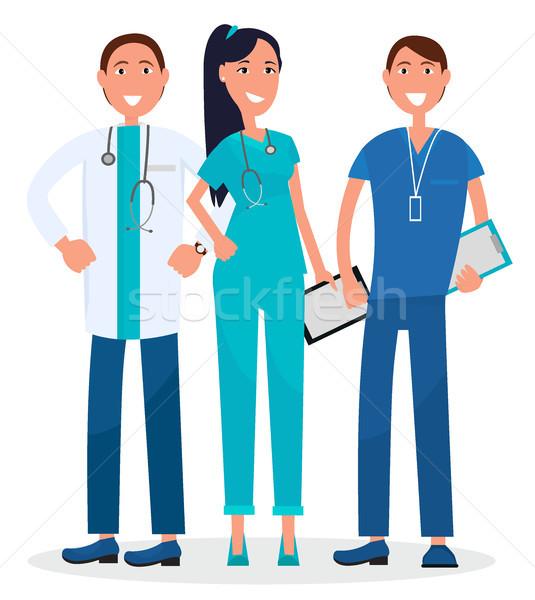 Trzy lekarze stałego uśmiechnięty graficzne odizolowany Zdjęcia stock © robuart