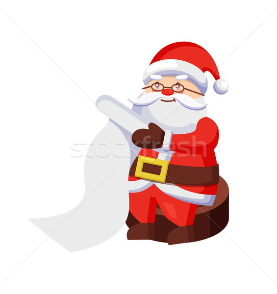 Santa Clauses with Wish List Sits on Wooden Stump Stock photo © robuart