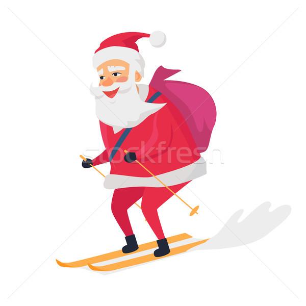 Skiing Happy Santa Clous on White Background Stock photo © robuart