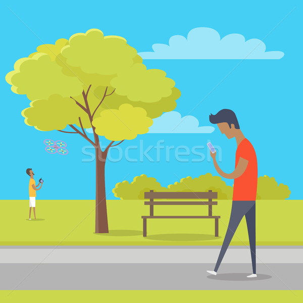Boy with Smartphone on Walk in Park out of Town Stock photo © robuart