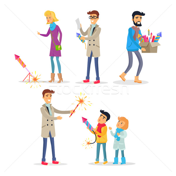 Adults and Children Setting off Bright Fireworks Stock photo © robuart