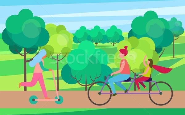 матери дочь верховая езда велосипед дерево парка Сток-фото © robuart