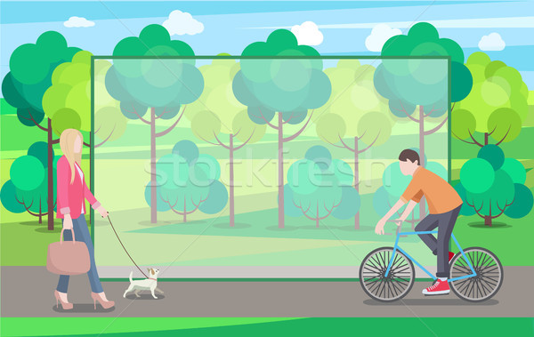 Man on Bike and Woman with Small Dog In Green Park Stock photo © robuart