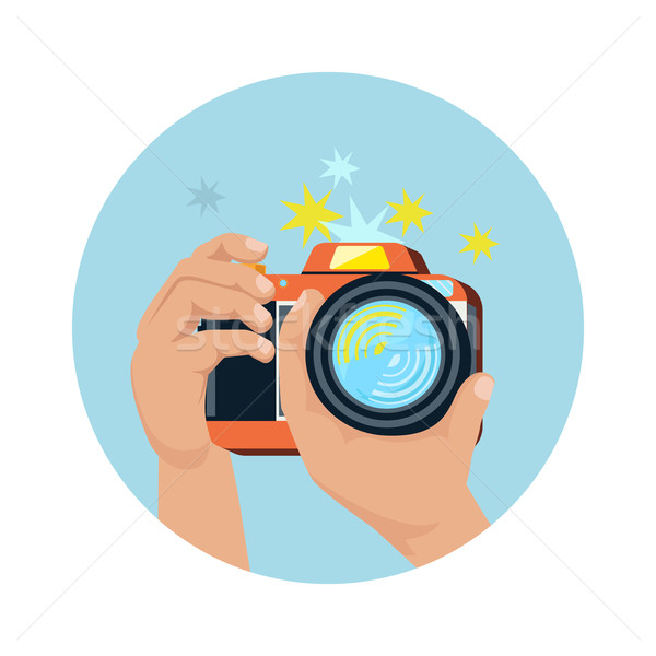 Hands holding camera and photographing Stock photo © robuart