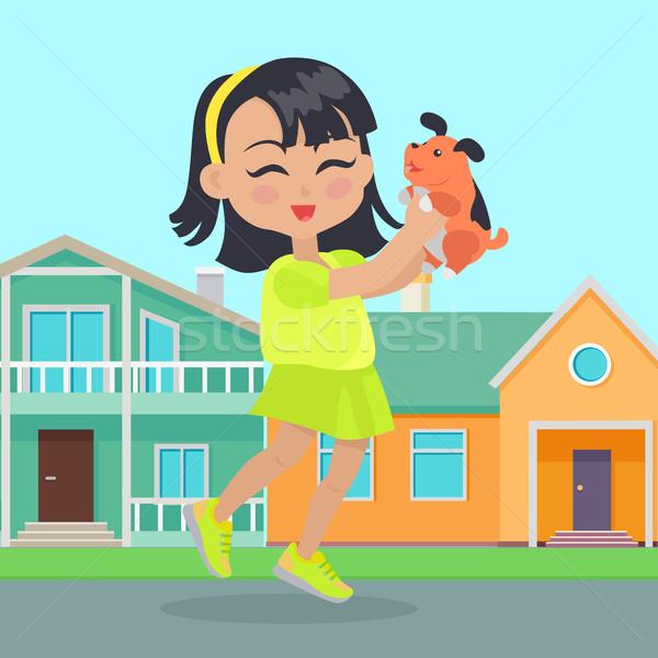 Lány kis kutya kezek házak kislány szabadidő Stock fotó © robuart