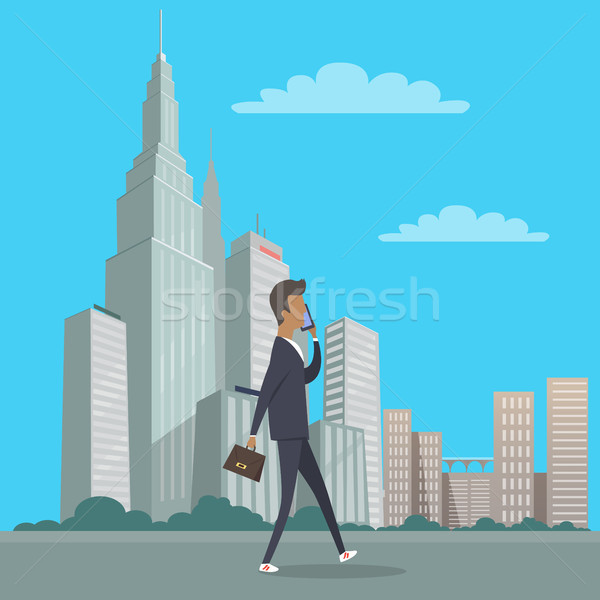 Businessman with Bag in Hand Walking in City Centre Stock photo © robuart