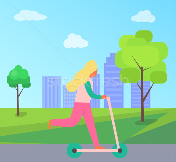 Woman Riding on Scooter Vehicle in City Park Stock photo © robuart