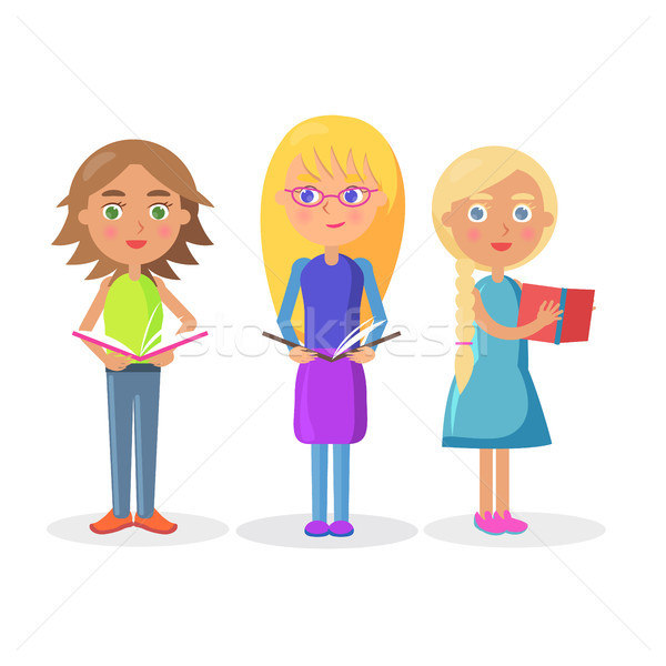 Három aranyos lányok tart nyitva tankönyvek Stock fotó © robuart