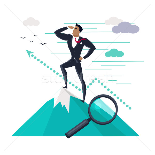 Businessman Standing on Top of Mountain Stock photo © robuart