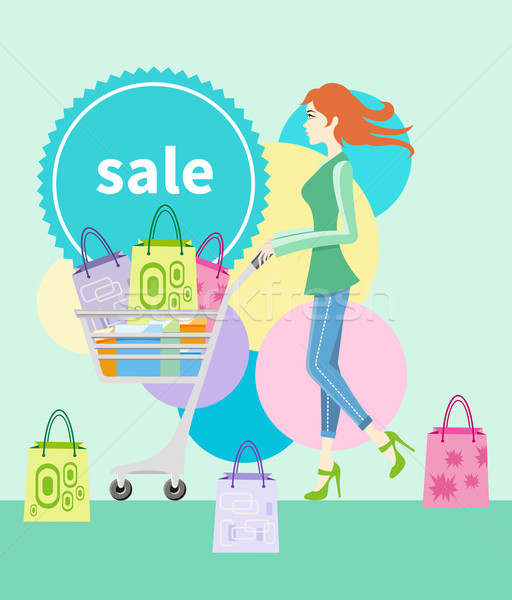 Shopping girl with trolley shopping bag with lable Stock photo © robuart