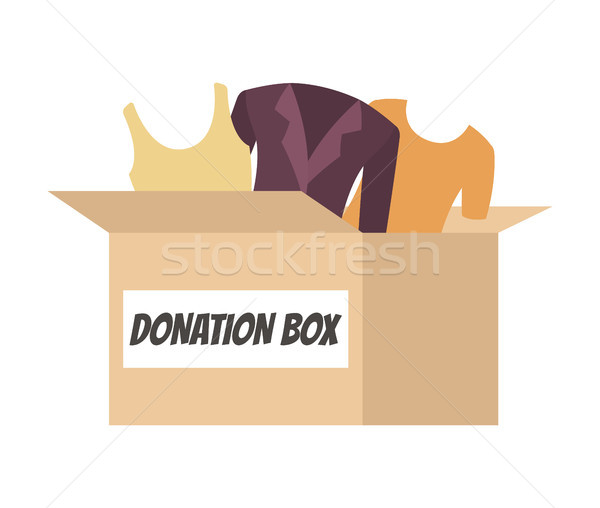 Stock photo: Donation Box Full of Clothes for People in Need