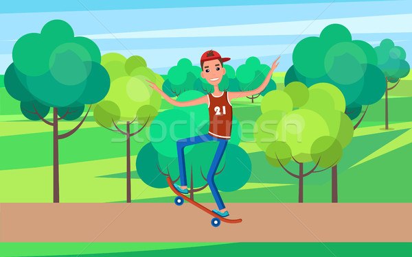 Skateboarder Training in Green Skatepark with Tree Stock photo © robuart