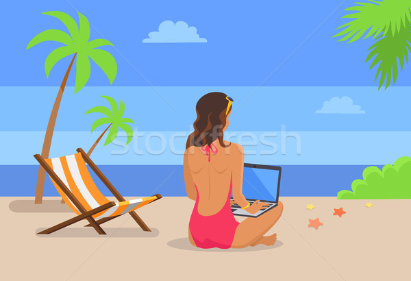 Girl-Freelancer Works on Laptop at Tropical Beach Stock photo © robuart