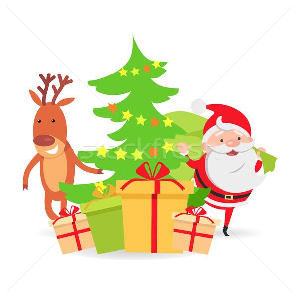 Santa Claus and Deer near Decorated X-mas Tree Stock photo © robuart