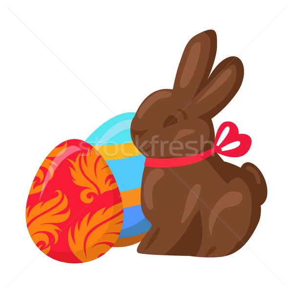 Sweet Chocolate Bunny and Two Multicolored Eggs Stock photo © robuart