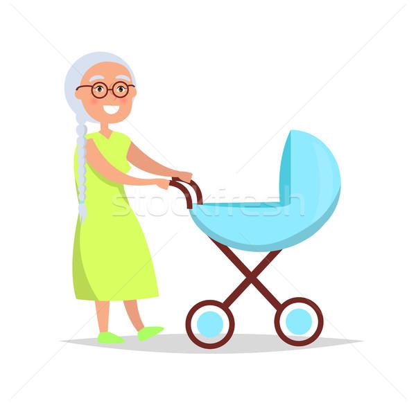 Idős hölgy hosszú szürke hordoz babakocsi Stock fotó © robuart
