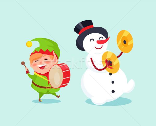Aranyos manó játszik dob hóember cintányér Stock fotó © robuart