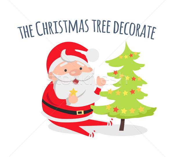 Santa Claus Decorate Xmas Tree Evergreen Fir Stock photo © robuart