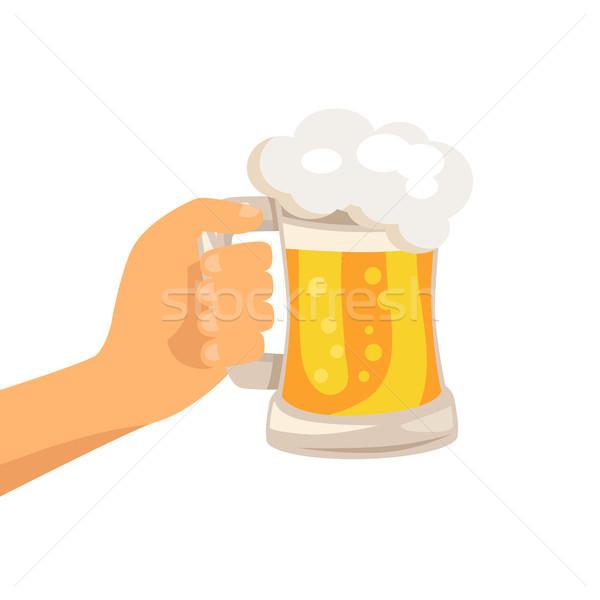 Main traditionnel verre bière mousse blanche Photo stock © robuart