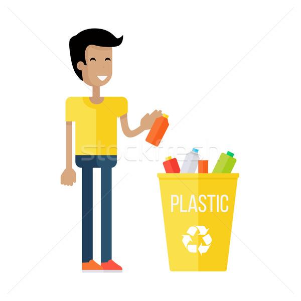 Residuos reciclaje nino amarillo camiseta azul Foto stock © robuart