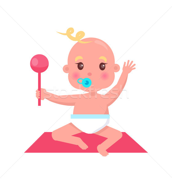 Little Baby with Pacifier and Rattle Sits on Rug Stock photo © robuart